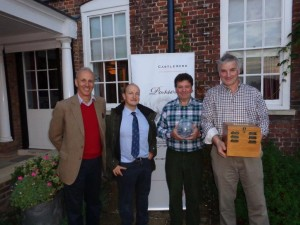 Castleacre's Hugo Johnsen and GWCT's Dr Roger Draycott present the Grey Partridge Conservation Award to Jimmie Laing and Robert Law (left to right)