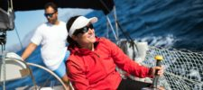 Benefits of Private Health Insurance showing a young woman enjoying sailing uou whole life insurance policies