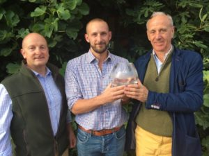 Adam Steed, receiving the Grey Partridge Conservation Award from Dr Richard Draycott GWCT and Castleacre Director Hugo Johnsen (Courtesy of the East Anglian Daily Times)